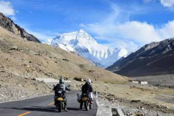 2 Motorcyclists in front of Everest